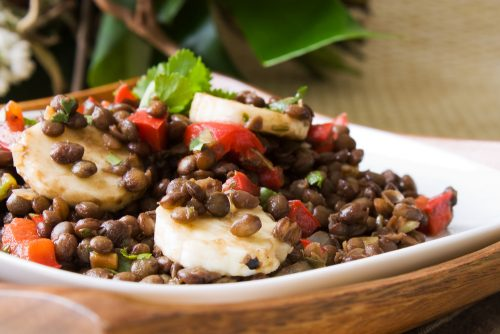 Selective focus image of a banana lentil salad, a vegetarian dish from South Africa. - shutterstock_66548119