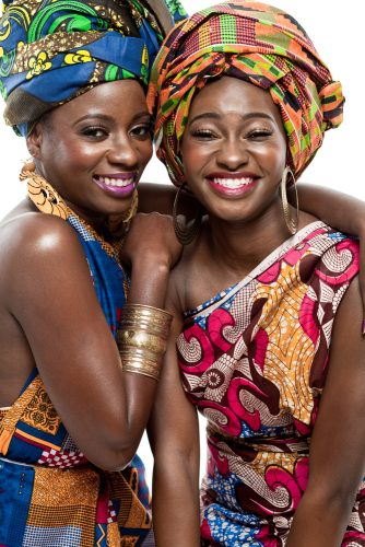 Two young beautiful African fashion models. - shutterstock_128584088