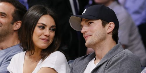 Actress Mila Kunis, left, and actor Ashton Kutcher, right, sit courtside together at the NBA basketball game between the Phoenix Suns and Los Angeles Lakers on Tuesday, February 12, 2013, in Los Angeles. (AP Photo/Danny Moloshok)